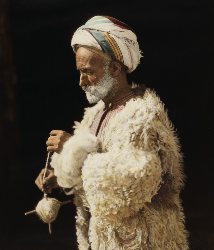 A peasant spinning wool in an American Colony in Ramallah